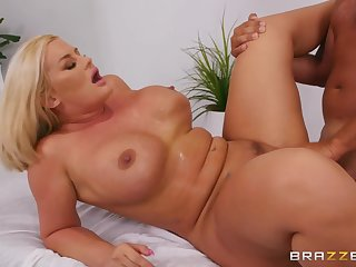 Julie Finances makes adulate with regard to Keiran Lee on the massage couch
